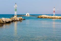 Старый венецианский маяк на гавани в Крите, Греции стоковое изображение