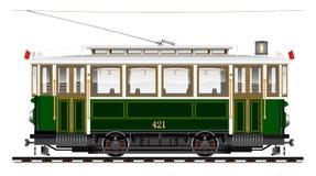 Старый двухосный трамвай зеленого цвета Переход города экологический Стоковые Фотографии RF