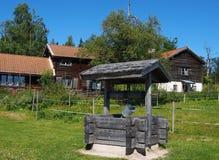 Старый деревянный фонтан в Fryksas Стоковые Фото