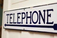 Старый знак комнаты телефона времени Стоковое фото RF