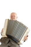 Старый игрок губной гармоники Стоковые Фото