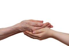 Старый и детеныш держа руки одина другого Стоковые Изображения RF