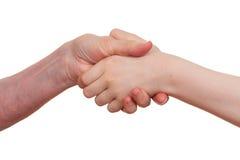 Старый и детеныш держа руки одина другого Стоковое Фото