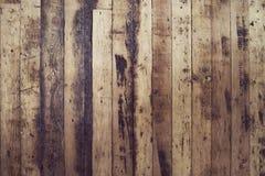 Старый и затрапезный пол планки текстурируют деревянное стоковое фото