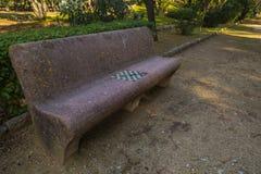 Старый каменный стенд с инкрустацией шахматной доски в парке Giulia виллы Стоковое Фото