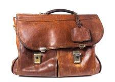 Старый кожаный портфель на белой предпосылке Стоковые Фотографии RF