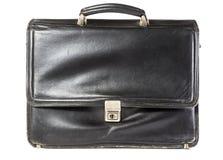 Старый кожаный портфель на белой предпосылке Стоковое фото RF