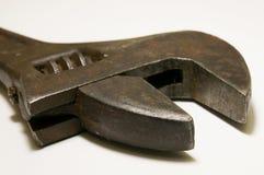 Старый крупный план регулируемого ключа моды на белизне Стоковая Фотография RF