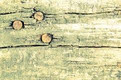 Старый кусок дерева с ногтями Справочная информация Стоковое Изображение