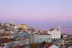 Старый Лиссабон на заходе солнца стоковая фотография rf