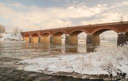 Старый мост кирпича в Kuldiga Стоковое Изображение