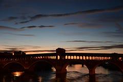 Старый мост на заходе солнца стоковое фото rf