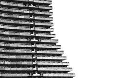 Старый, незаконченный, панель, здание мульти-этажа на белой предпосылке Стоковые Фотографии RF