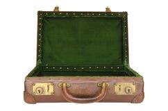 Старый несенный открытый чемодан с зеленым интерьером Стоковое фото RF
