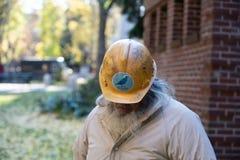 Старый парень в шляпе шлифовальных приборов Bernie трудной стоковые изображения