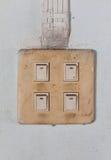 Старый переключатель на стене цемента Стоковые Изображения
