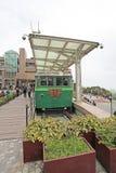 Старый пиковый поезд на ориентир ориентире пика Виктории, Гонконге Стоковое Изображение RF