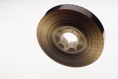 Старый позитв прокладка фильма 16 mm на белой предпосылке Стоковые Фото