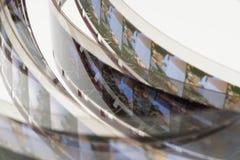 Старый позитв прокладка фильма 16 mm на белой предпосылке Стоковое фото RF