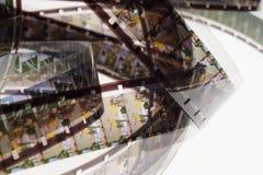 Старый позитв прокладка фильма 16 mm на белой предпосылке Стоковая Фотография RF