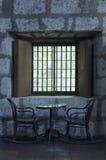 Старый пообедайте комплект около окна Стоковая Фотография