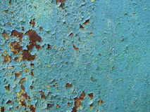 Старый ржавый металл с голубой предпосылкой одним краски стоковое фото rf