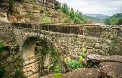"""Старый римский мост как известно как """"мост Bugrum или Oluk """" Ландшафт реки Koprucay от национального парка каньона Koprulu, Антал стоковые изображения rf"""