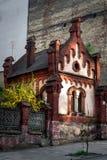 Старый средневековый красный небольшой дом в Львове Стоковые Изображения