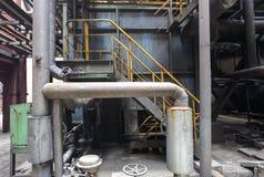 Старый сталелитейный завод с трубами и клапанами Стоковое фото RF
