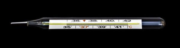 Старый стеклянный классический изолированный термометр ртути Стоковое фото RF