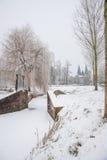Старый строб города в парке города зимы Стоковые Изображения