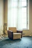 Старый стул окном Стоковое фото RF
