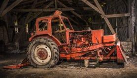 Старый сломанный трактор Стоковое фото RF