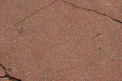 Старый треснутый красный асфальт Стоковые Изображения RF