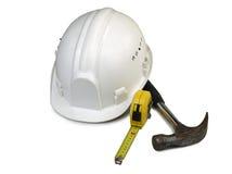 старый трудный шлем с используемыми инструментами Стоковое Изображение
