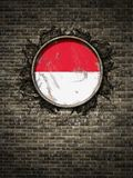 Старый флаг Индонезии в кирпичной стене иллюстрация штока