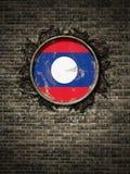 Старый флаг Лаоса в кирпичной стене бесплатная иллюстрация