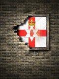 Старый флаг Северной Ирландии в кирпичной стене Стоковое фото RF