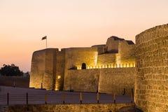 Старый форт Бахрейна на Seef на заходе солнца Стоковые Изображения