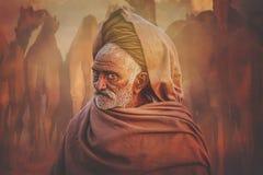Старый человек Rajasthani на фоне его верблюдов Стоковые Изображения