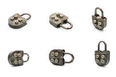 Старый padlock с обеспеченный кодом, изолированным на белой предпосылке с тенями, комплект Стоковые Изображения