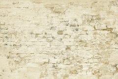 Старым бежевым покрашенная кирпичом текстура предпосылки стены Стоковое Изображение