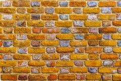 Старым покрашенная кирпичом предпосылка masonry кирпича Стоковая Фотография