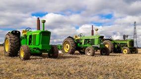 3 старых винтажных трактора John Deere Стоковые Фото