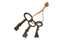 3 старых ключа от двери связанной с веревочкой Стоковые Фото