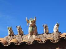 Статуи идола поголовья глины на входе к Raqch'i или виске Wiracocha, Перу Стоковые Фотографии RF