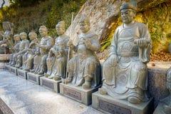 Статуи Sroned на 10 тысяч монастыре Buddhas в олове Sha, Гонконге, Китае Стоковые Фото