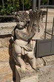 Статуя ангела младенца Стоковые Изображения
