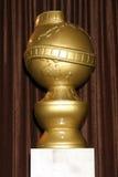 статуя глобуса золотистая Стоковая Фотография