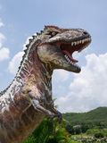 Статуя динозавра в тематическом парке Стоковые Фото